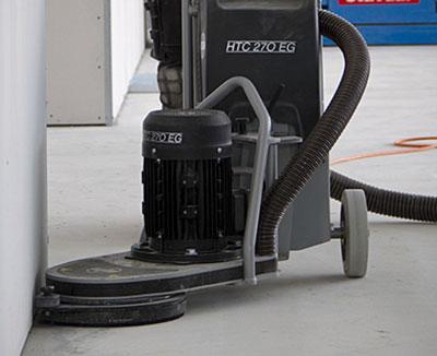 HTC concrete edge floor grinder in use