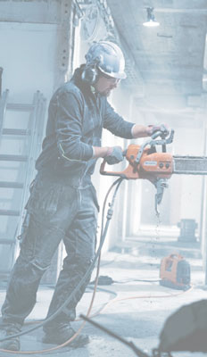 Husqvarna K6500 chain saw in use